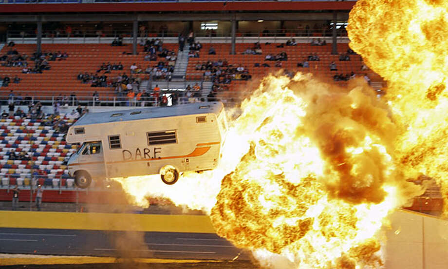 Spanky Spangler performs a stunt prior to the NASCAR Sprint Cup Series auto race at Charlotte Motor Speedway in Concord, N.C., Saturday, Oct. 16, 2010. Photo: Terry Renna, AP