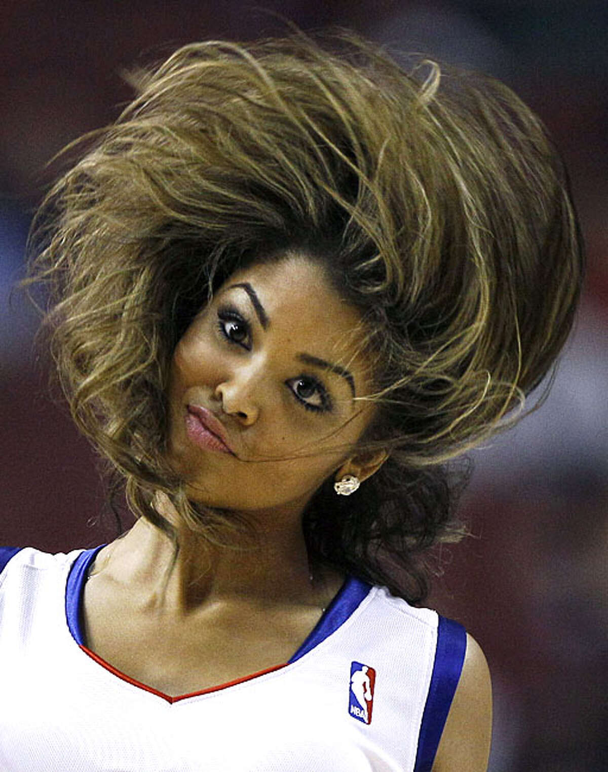 A Philadelphia 76ers' cheerleader performs in the second half of an NBA basketball game against the Portland Trail Blazers, Tuesday, Nov. 30, 2010, in Philadelphia. Philadelphia won 88-79.