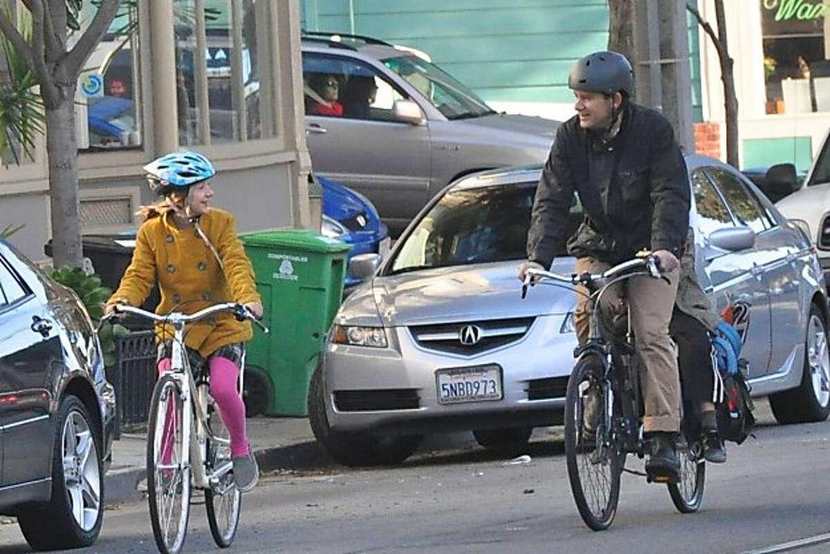 Many San Francisco kids and parents, like Hannah and Jonn Herschend, enjoy biking to school together.