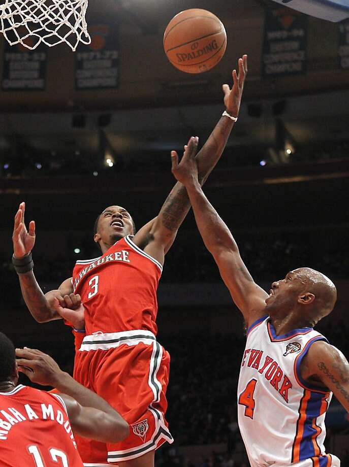 Milwaukee Bucks' Brandon Jennings (3) puts up a layup in front of New York Knicks' Chauncey Billups (3) during the first half of an NBA basketball game at Madison Square Garden in New York, Friday, March 25, 2011. Photo: Paul J. Bereswill, AP