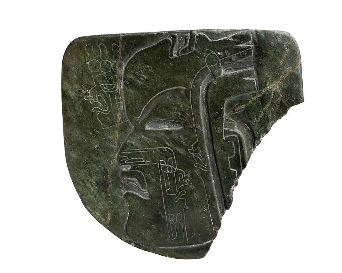 Plaque with carved human profile (c. 800 B. C.) greenstone (Olmec -artist unknown)
