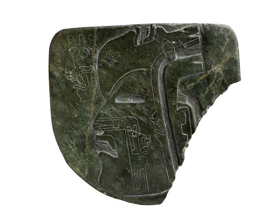 Plaque with carved human profile (c. 800 B. C.) greenstone (Olmec -artist unknown) Photo: Javier Hinojosa, Fine Arts Museums Of S.f.