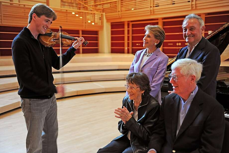 Violinist David McCaroll performs for a select audience at the Green Music Center, including benefactors Joan and Sandy Weill, standing, and Maureen and Donald Green. Photo: Linnea Mullins, Green Music Center