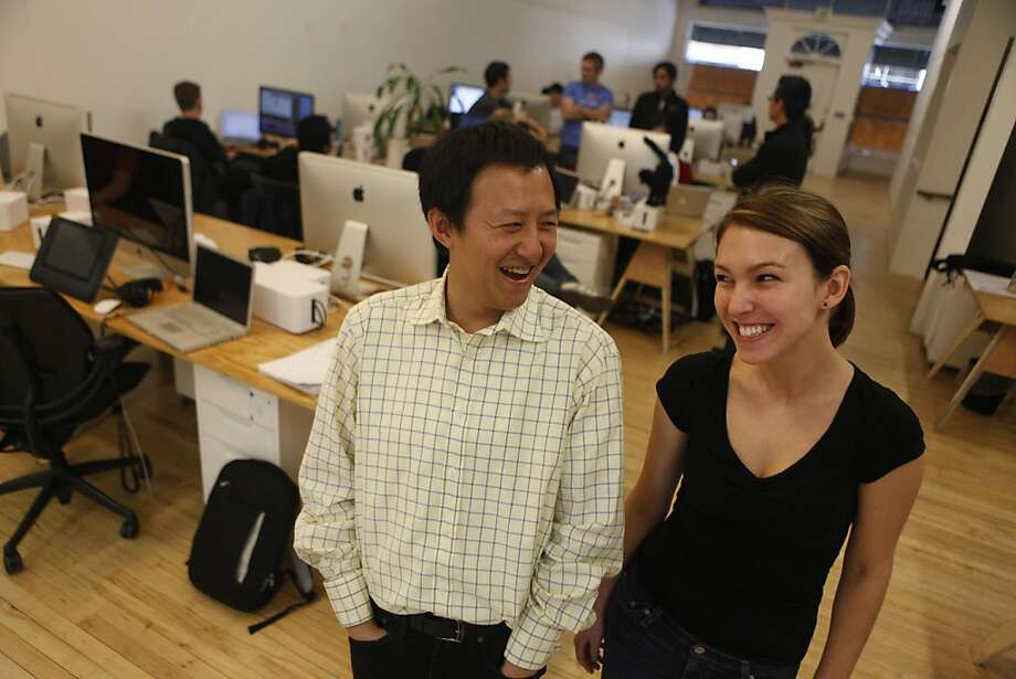 Color co-founder Bill Nguyen and Megan Stretch are seen on Thursday, March 10, 2011 in Palo Alto, Calif. at Color's offices. Color is developing an app that lets people near each other automatically share their photos. Photo: Lea Suzuki, The Chronicle
