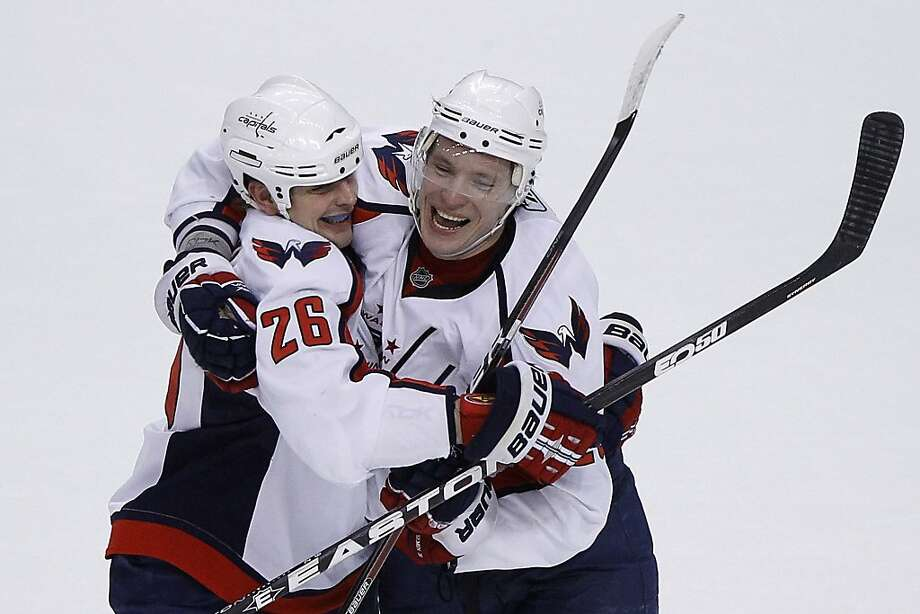 Washington Capitals' Alexander Semin, right, of Russia, and Matt Hendricks celebrate after Semin's goal against the Philadelphia Flyers in an overtime shootout during their NHL hockey game, Tuesday, March 22, 2011, in Philadelphia. Washington won 5-4. Photo: Matt Slocum, AP