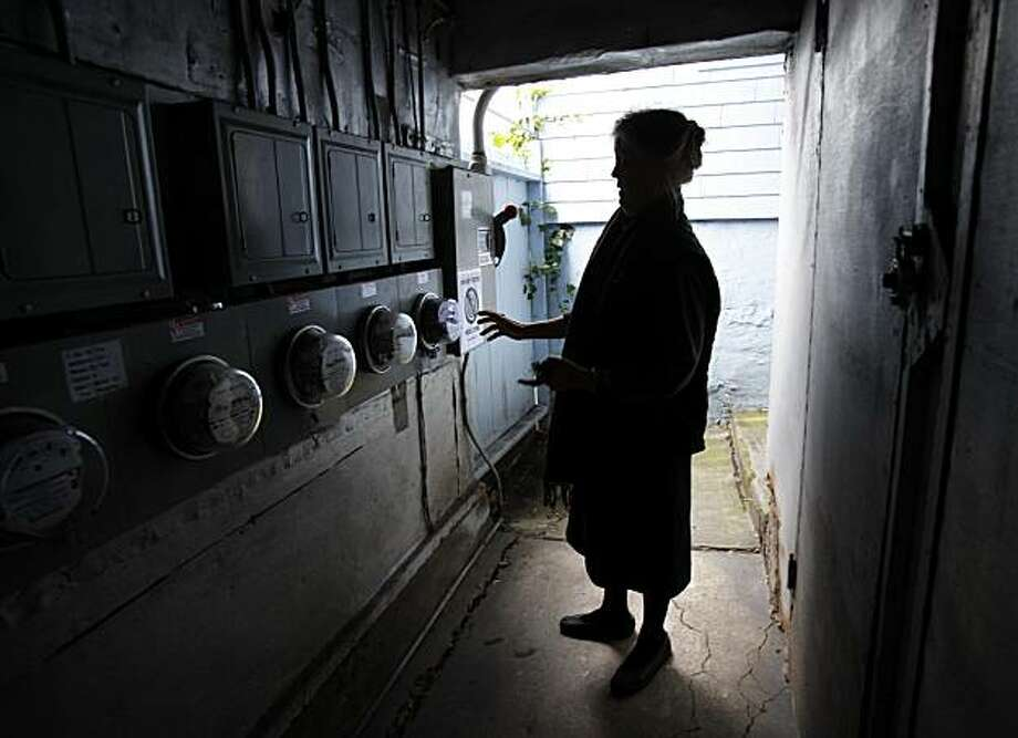 "Maya Cain stands by the electric meters directly below her bedroom. She got PG&E to remove her SmartMeter. Maya Cain believes her ""electrosensitivity"" started after PG&E installed one of their controversial wireless SmartMeters in her San Francisco, Calif. apartment building a few feet below her bed.  She also complains of dizziness, memory loss and ringing in her ears from other electromagnetic fields near her home Wednesday September 8, 2010. Photo: Brant Ward, The Chronicle"