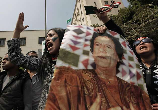 A pro-Gadhafi protester carries a picture of Libyan leader Moammar Gadhafi and chants anti-U.N. slogans as demonstrators block the path of UN Secretary-General Ban Ki-moon, unseen as he was leaving the Arab League headquarters on his way to Tahrir Squareafter meeting with Arab League chief Amr Moussa, in Cairo, Egypt, Monday, March 21, 2011. A group of protesters angry about international intervention in Libya blocked the path of U.N. Secretary-General Ban Ki-Moon as he left a meeting at the Arab League. Photo: Nasser Nasser, AP