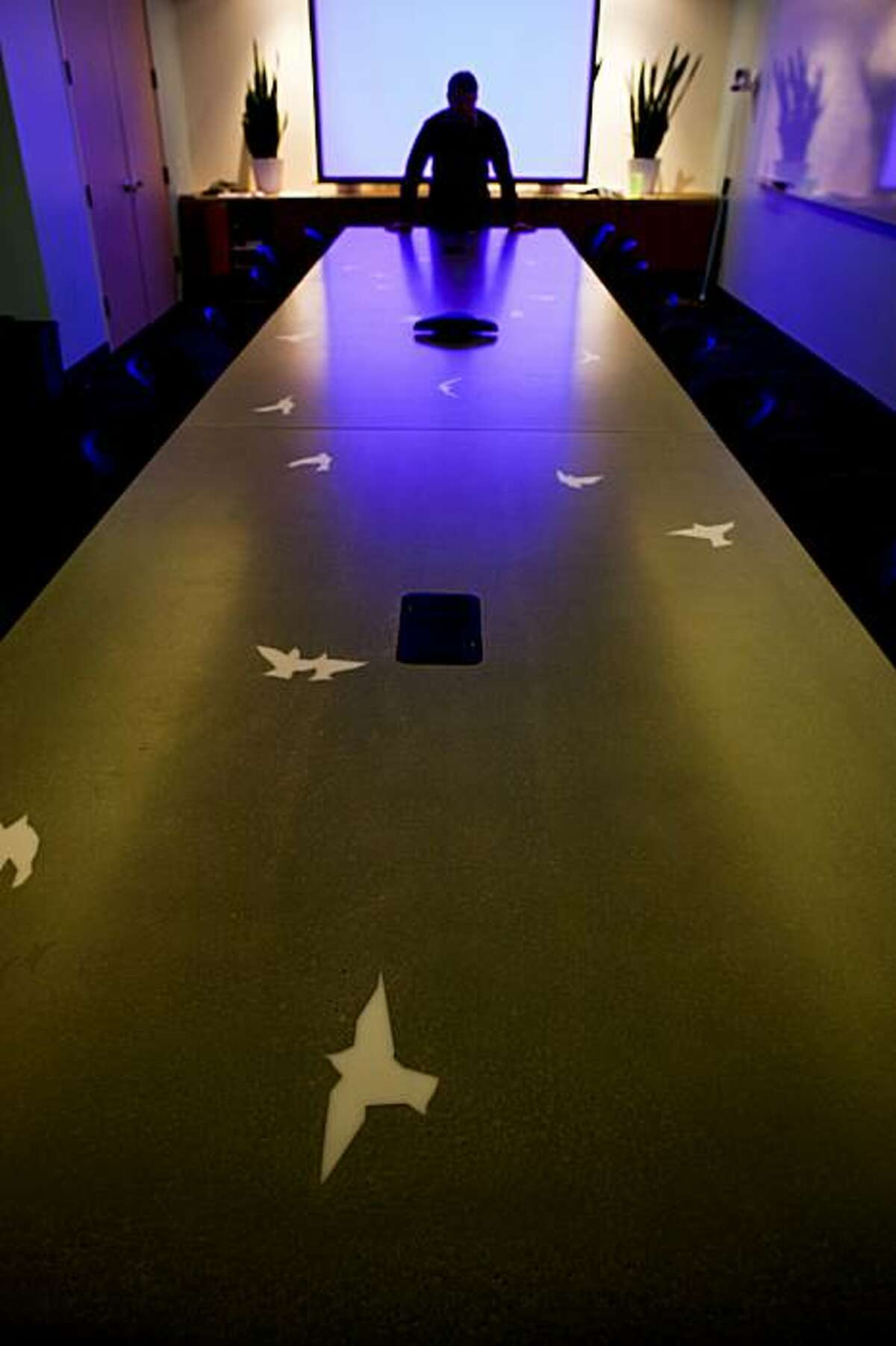 A table with inlaid acrylic birds made by Concrete Works sits in one of the conference rooms the new Twitter offices seen in San Francisco, Calif. on Wednesday, Dec. 16, 2009.