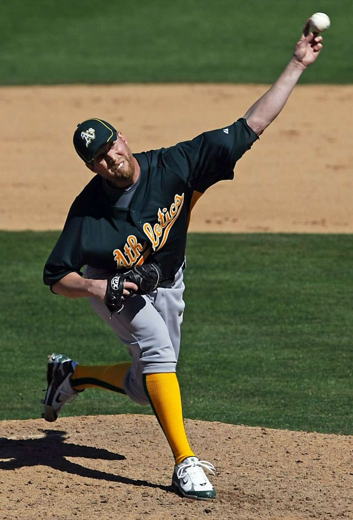 Oakland Athletics pitcher Josh Outman throws to the Chicago Cubs in the first inning of a spring training game at HoHoKam Park in Mesa, Ariz., on Sunday.