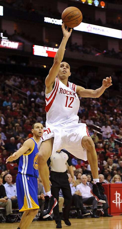 Houston Rockets Kevin Martin (12) drives past Golden State Warriors' Stephen Curry, left, during the first quarter of an NBA basketball game, Wednesday, March 23, 2011, in Houston. Photo: Dave Einsel, AP