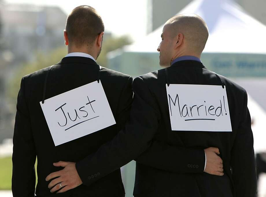 Same-sex couple Ariel Owens (right) and his spouse Joseph Barham walk arm in arm after they were married at San Francisco City Hall June 17, 2008 in San Francisco, California. Same-sex couples throughout California are rushing to get married as counties begin issuing marriage license after a State Supreme Court ruling to allow same-sex marriage. Photo: Justin Sullivan, Getty Images