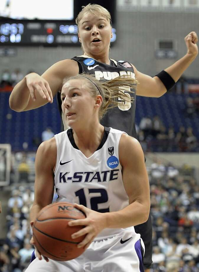 Kansas State's Taelor Karr, bottom, is guarded by Purdue's Brittany Rayburn during the first half of an East Regional first-round NCAA women's college tournament basketball game in Storrs, Conn., Sunday, March 20, 2011. Photo: Jessica Hill, AP