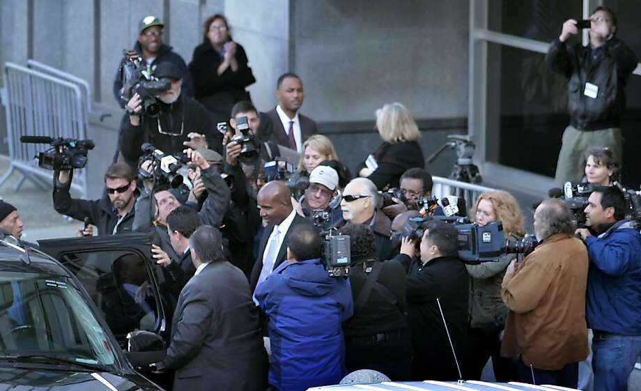 The media circles Barry Bonds as he leaves the  Federal Court Building, Monday, March 21, 2011, in San Francisco, Calif. The first  day of the perjury trial ended  with jury selection. Photo: Lacy Atkins, The Chronicle