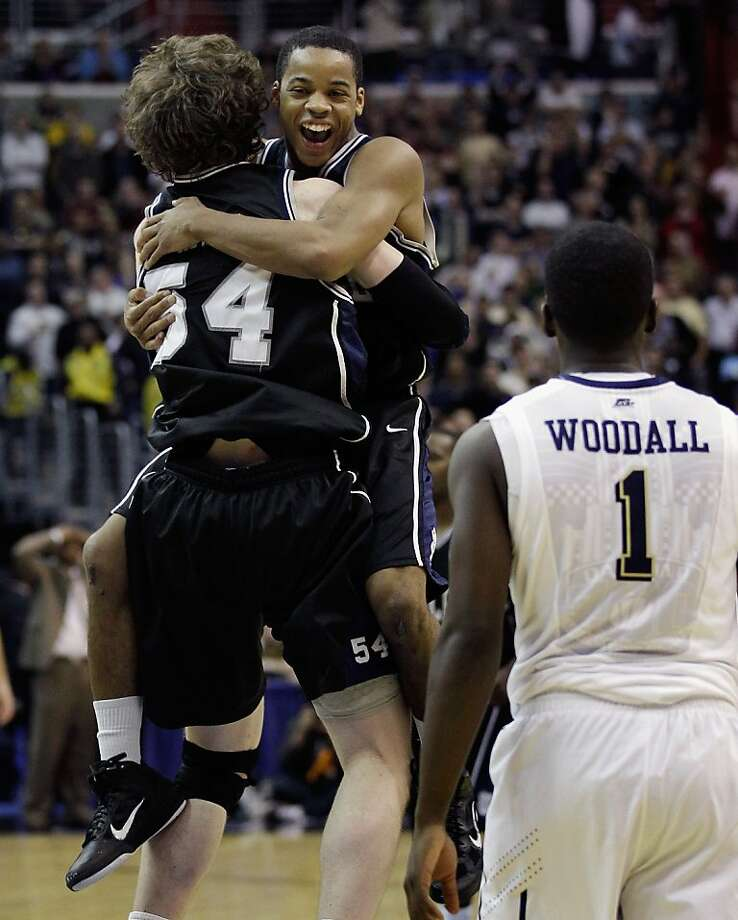 WASHINGTON - MARCH 19:  After making the game winning free throw, Matt Howard #54 of Butler jumps into the arms of teammate Zach Hahn #3 as Pittsburgh's Travon Woodall #3 looks on following  their game in the third round of the 2011 NCAA men's basketballtournament at Verizon Center on March 19, 2011 in Washington, DC. Butler won the game 71-70. Photo: Rob Carr, Getty Images