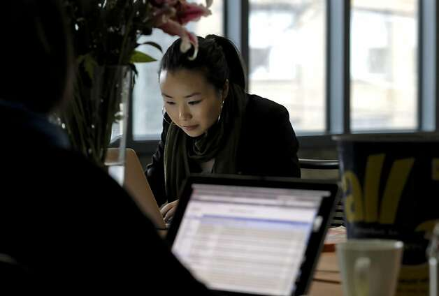 "Joyce Leung, account management, working at the south of Market Street offices of ""PeopleBrowsr"" on Thursday Mar. 24, 2011, in San Francisco, Ca. Photo: Michael Macor, The Chronicle"