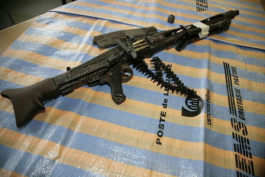 This handout photo provided by Vilnius Territorial Customs Office shows a German machine gun dating back from World War II, complete with ammunition that was found at the airport of Lithuanian capital Vilnius Tuesday, March 22, 2011. Lithuanian officials said they found the weapon in a suspicious package posted in Lithuania and bound for Germany. (AP Photo/Vilnius Territorial Customs Office ) Photo: Vilnius Territorial Customs Offi, Associated Press
