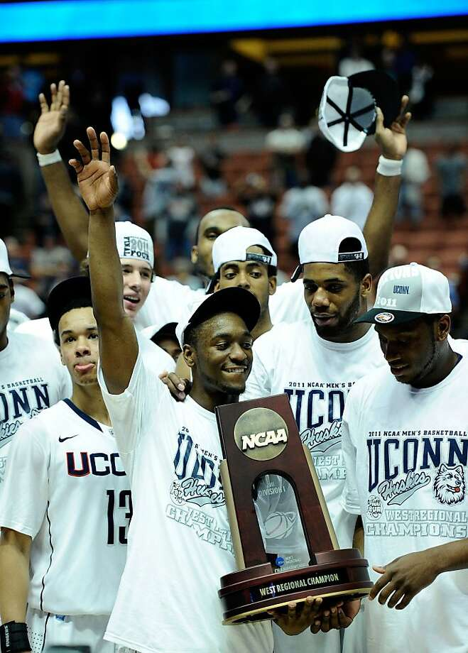 ANAHEIM, CA - MARCH 26:  Kemba Walker #15 and the Connecticut Huskies celebrate with the trophy after defeatng the Arizona Wildcats to win the west regional final of the 2011 NCAA men's basketball tournament at the Honda Center on March 26, 2011 in Anaheim, California. Photo: Kevork Djansezian, Getty Images