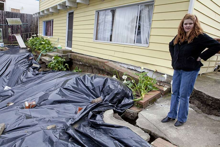 Blanka Walker in the backyard of her San Pablo home in San Pablo, Calif. on Saturday, March 26, 2011.  Walker's entire porch and backyard slide down the hill after Thursday's torrential downpours.    Kat Wade / Special to the Chronicle Photo: Kat Wade, Special To The Chronicle