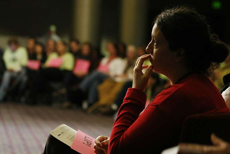 Meghan McGowan, a first year teacher at Joaquin Miller Elementary School who received a pink slip listens to public officials speak about budget cuts in the Alameda County education system at a town hall meeting at Oakland City Hall in Oakland Calif, on Saturday March 26, 2011. Photo: Alex Washburn, The Chronicle