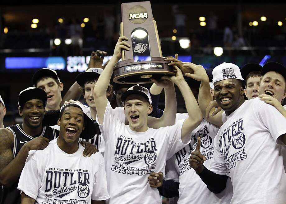 Butler players hold up the Southeast Regional Championship Trophy after their NCAA Southeast regional college basketball championship game against Butler Saturday, March 26, 2011, in New Orleans.Butler won 74-71 to advance to the Final Four. Photo: David J. Phillip, AP