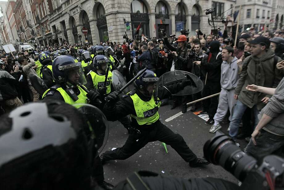 British riot police officers clash with demonstrators against the coalition government's spending cuts, in central London, Saturday, March 26, 2011. Hundreds of thousands of mostly peaceful demonstrators streamed into central London on Saturday to march against government budget cuts. Photo: Lefteris Pitarakis, AP
