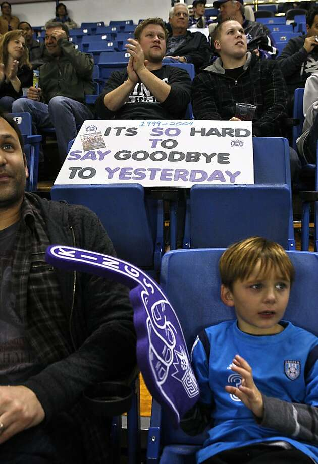 Tony Swift (left, front) with his son Max Swift (right, front), 5 years old,  and David Matson (left, back), from Sacramento, and Jared Fore (right, back), from Lincoln watch as the Sacramento Kings play the Philadelphia 76ers at the Power Balance Pavilion in Sacramento, Calif., on Friday, March 18, 2011.  The NBA team will probably move out of town. Photo: Liz Hafalia, The Chronicle