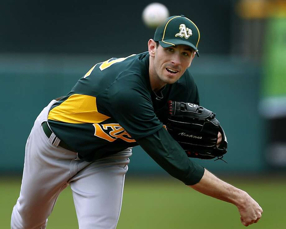 Starter Brandon McCarthy pitches in the first inning of the Oakland A's 6-4 win over the San Francisco Giants in a spring training game at Scottsdale Stadium in Scottsdale, Ariz., on Sunday. Photo: Paul Chinn, The Chronicle