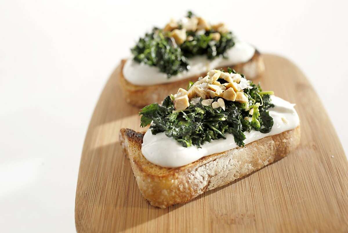 Nettle and whipped ricotta crostini as seen in San Francisco, California, on March 16, 2011. Food styled by Sophie Brickman.