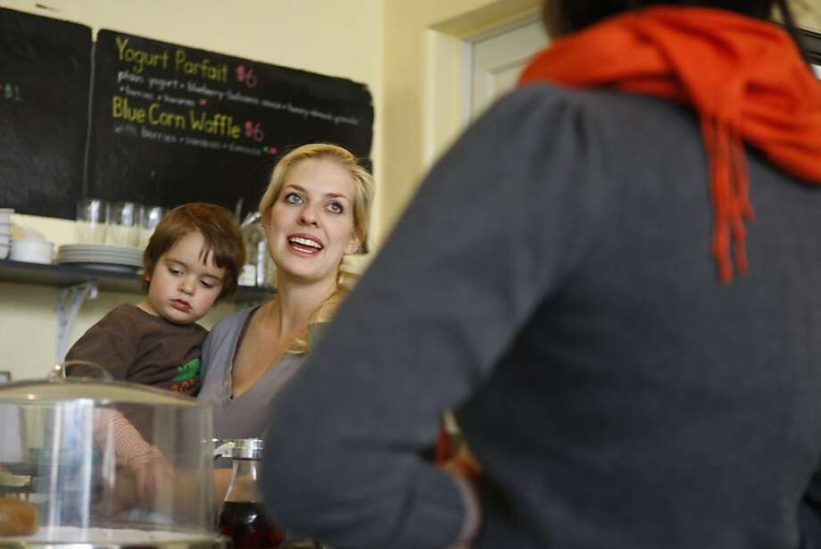 Chelsea Addison-Torress speaks to a customer while holding her son Nico at Little Bird Cafe in San Francisco Calif, on Friday, March 4, 2011. Photo: Alex Washburn, The Chronicle