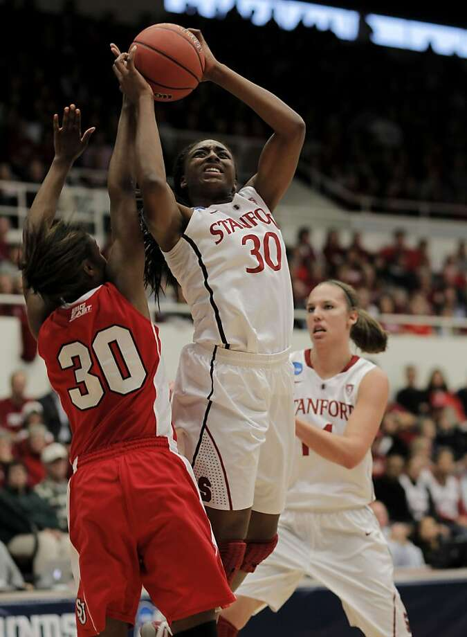 Stanford's Nnemkadi Ogwumike (30) fires a shot over St. John's Centhya Hart (30) in the second round of the NCAA Tournament on Monday at Maples Pavilion in Palo Alto. Photo: Michael Macor, The Chronicle