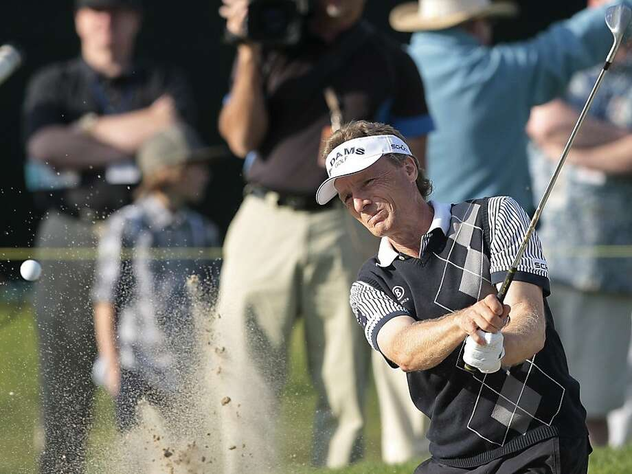 Bernhard Langer of Germany hits from a bunker to the 15th green during the second round of the Toshiba Classic Championship golf tournament in Newport Beach, Calif., Saturday, March 12, 2011. Photo: Jason Redmond, AP