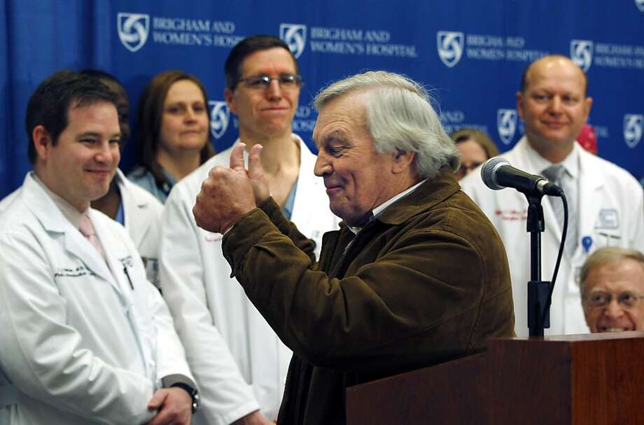 Del Peterson, grandfather of face transplant recipient Dallas Wiens, turns and gives thumbs up to the surgical team during a news conference at Brigham and Women's Hospital in Boston Monday, March 21, 2011. Dallas Wiens, 25, a Fort Worth, Texas construction worker badly disfigured in a power line accident two years ago has received the nation's first full face transplant last week at Brigham and Women's. Photo: Elise Amendola, AP