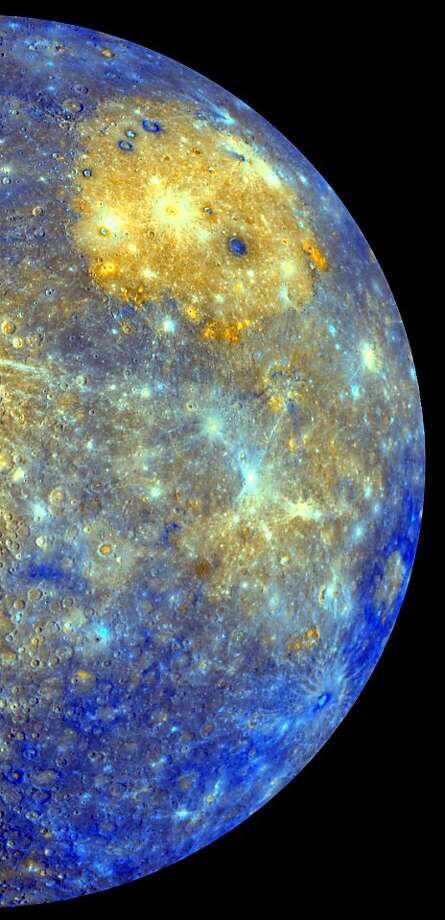 This image released by NASA shows an enhanced photo image of Mercury from its Messenger probeÍs 2008 flyby of the planet. NASA says it was a taste of pictures likely to come after March 17, 2011, when the probe enters MercuryÍs orbit. This photo showsthe eastern part of the smallest and closest planet in our solar system. The colors in this picture are different than what would be seen with the naked eye, but show information about the different rock types and subtle color variations on the oddball planet. The bright yellow part is the Caloris impact basin, which is the site of one of the biggest in the solar system. For the first time, Earth has a regular orbiting eye-in-the-sky spying on the solar system's smallest and strangest planet, Mercury. Photo: Nasa, Associated Press