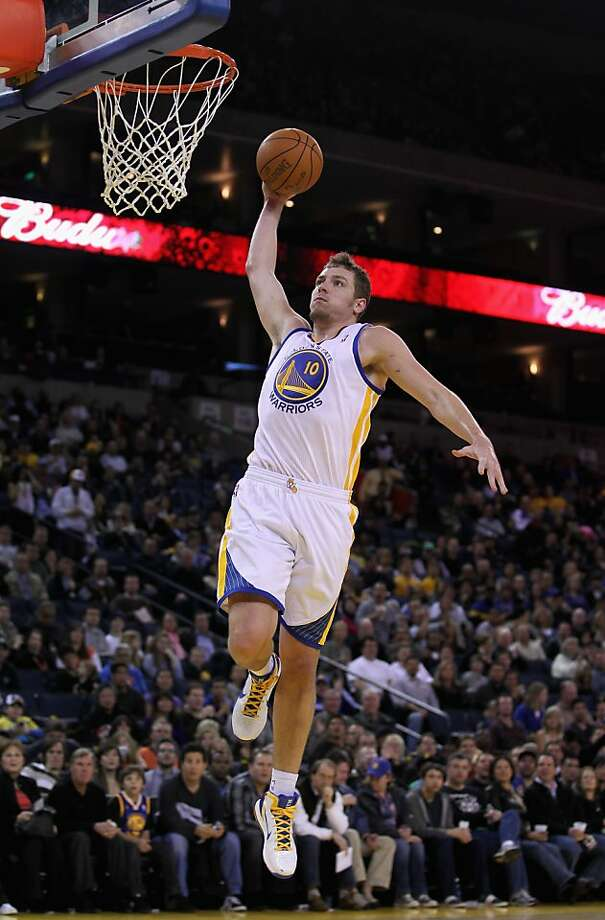 OAKLAND, CA - MARCH 25: David Lee #10 of the Golden State Warriors goes up for a dunk against the Toronto Raptors at Oracle Arena on March 25, 2011 in Oakland, California. NOTE TO USER: User expressly acknowledges and agrees that, by downloading and or using this photograph, User is consenting to the terms and conditions of the Getty Images License Agreement. Photo: Ezra Shaw, Getty Images