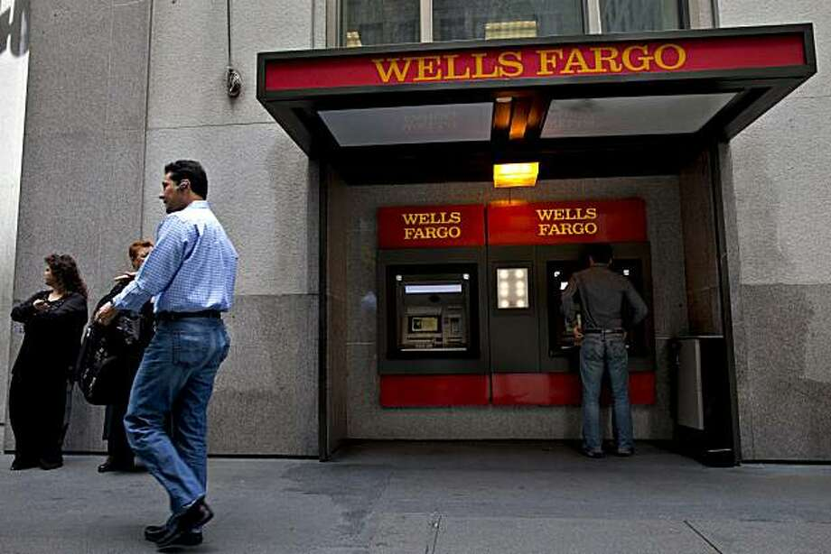 A patron uses a Wells Fargo & Co. ATM in San Francisco, California, U.S., on Tuesday, April 27, 2010. Wells Fargo & Co., the fourth-largest U.S. bank by assets and deposits, may raise its dividend once capital levels satisfy regulators and if the economic recovery continues, said Chief Executive Officer John Stumpf. Photographer: David Paul Morris/Bloomberg Photo: David Paul Morris, Bloomberg