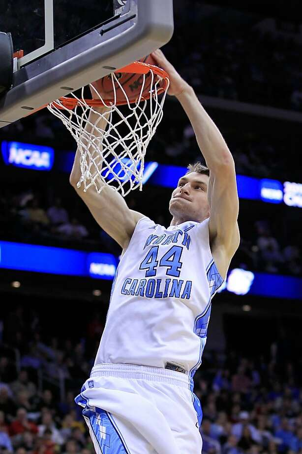 NEWARK, NJ - MARCH 25:  Tyler Zeller #44 of the North Carolina Tar Heels dunks the ball against the Marquette Golden Eagles Tyler Zeller  the east regional semifinal of the 2011 NCAA Men's Basketball Tournament at the Prudential Center on March 25, 2011 in Newark, New Jersey. Photo: Chris Trotman, Getty Images