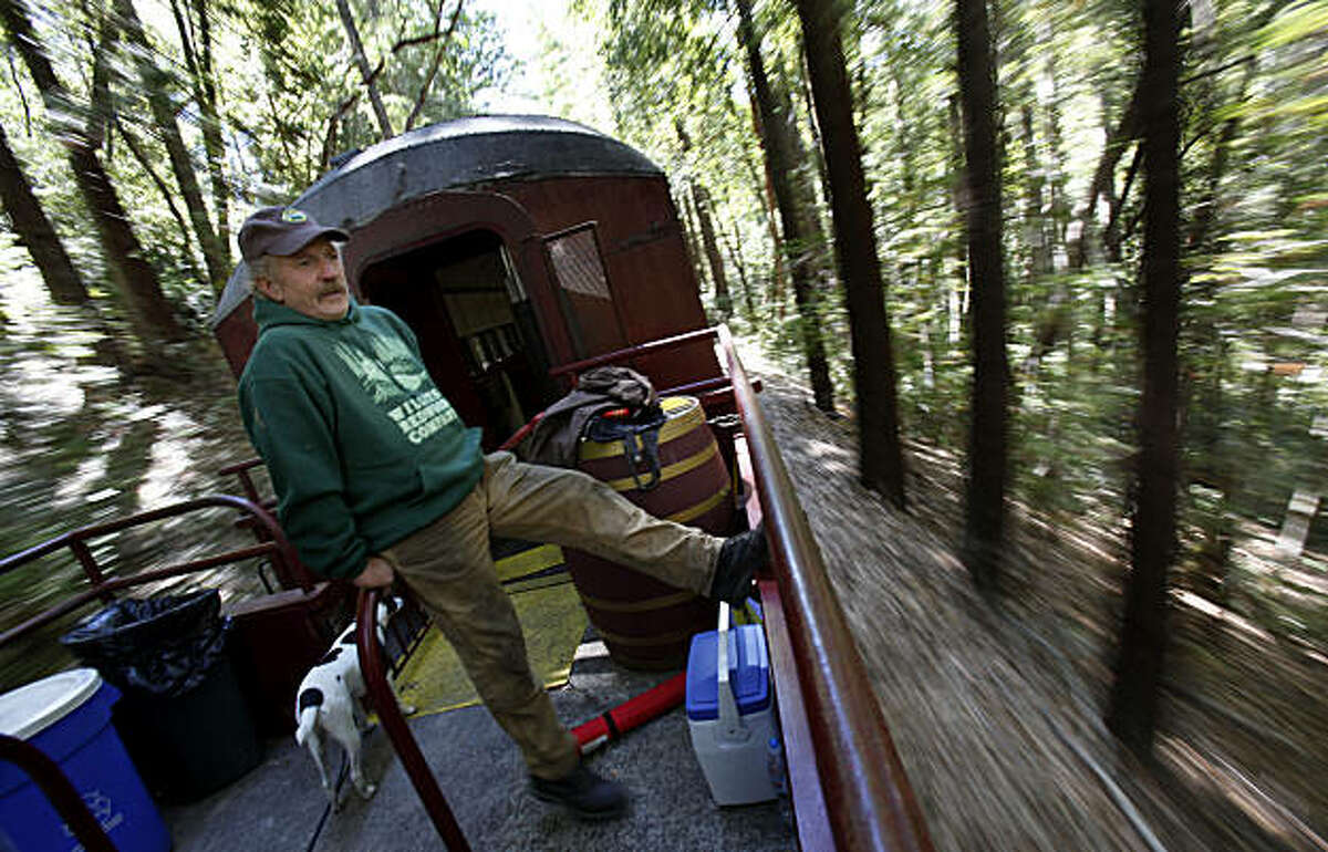 Chris Baldo, the owner of the Willits lumber company that sold the land to Save the Redwoods League, watches the timber fly by as he rides on the Skunk Train through the property. Save the Redwoods League has a 428 acre property high in the Noyo River watershed of Mendocino County to purchase from the Willits Redwood Company.
