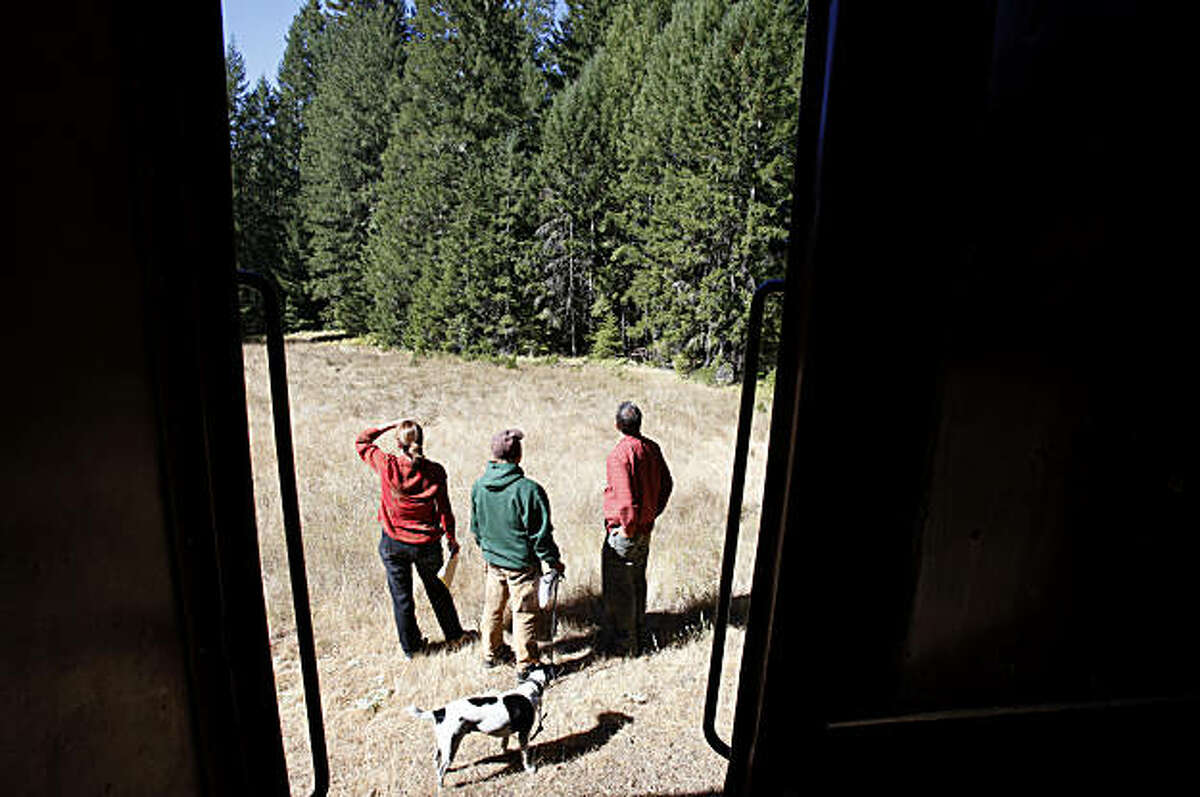 Members of the Save the Redwoods League and Willits Redwood Company owner Chris Baldo (center) gaze out at the purchased forest after disembarking the Skunk Train. Save the Redwoods League has a 428 acre property high in the Noyo River watershed of Mendocino County to purchase from the Willits Redwood Company.