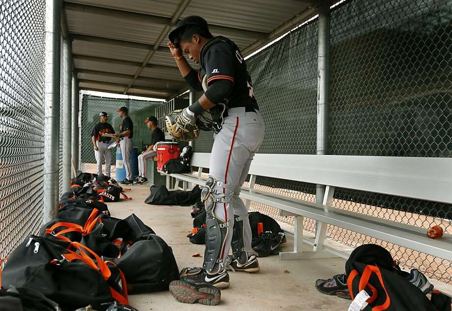 Gabriel Cornier, a 19-year-old catcher from Venezuela, puts on his gear in a dugout at the Giants Baseball Complex in Scottsdale, Ariz. on Sunday, March 20, 2011. Photo: Paul Chinn, The Chronicle