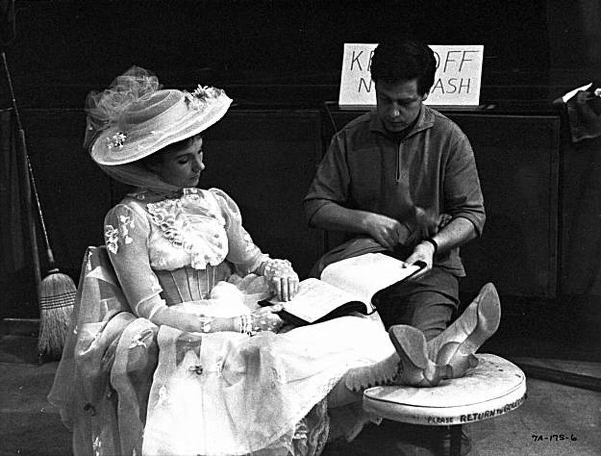 Julie Andrews talks to her husband, designer Tony Walton, during a lull in production of,