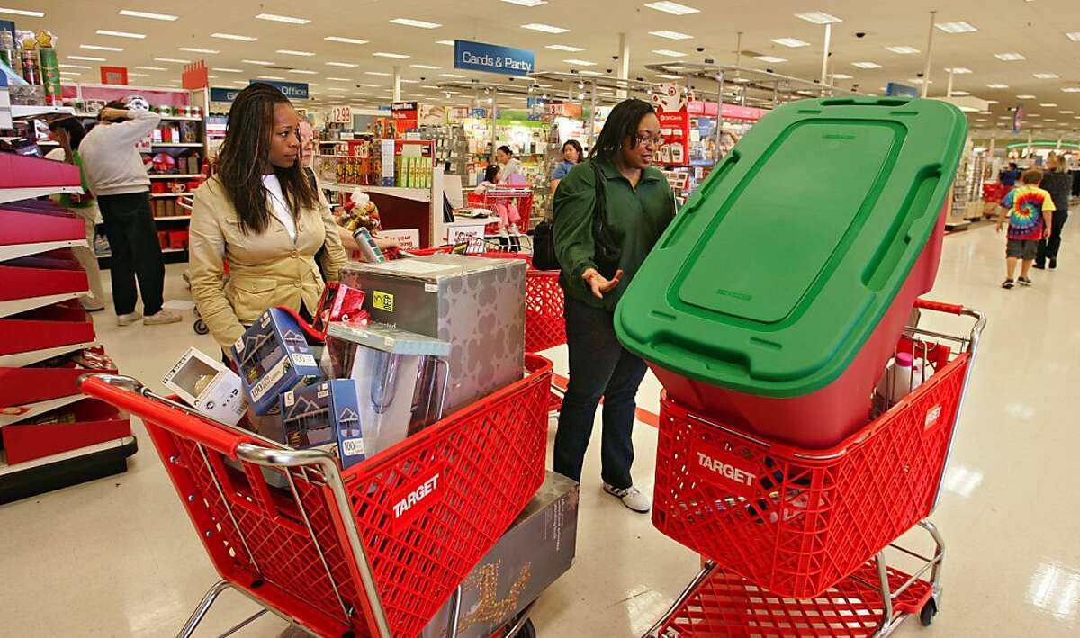 Tanisha Morris (left) and her friend Donye Frazier stock up on post Xmas sale items at Target in San Leandro. The retail scene at the Bayfair Center mall in San Leandro on the day after Christmas - how the holiday season turned out financially for retailers, plus what the mood is among shoppers on the day after Christmas, which typically is the second biggest shopping day of the year. Some of the stores in Bayfair such as Macy's and Kohl's open at 7 am so we will be catching the early-bird shoppers who want to take advantage of Big Sales.
