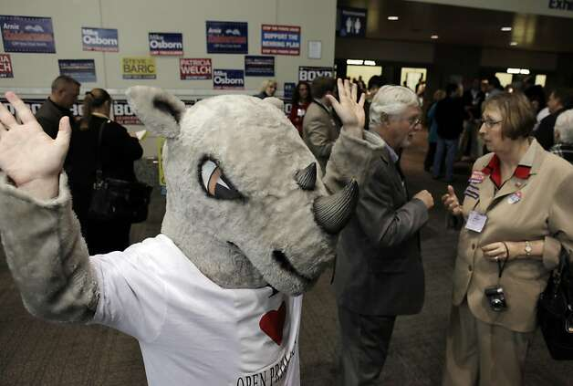 Scott Carpenter of Orange County, dressed as a RINO Rhino (Republican In Name Only) protests new primary system based on Prop. 14. A thousand delegates and republicans from around the state gathered at the Sacramento Convention Center for the California Republican Party Convention in Sacramento, Calif., on Saturday, March 19, 2011. Photo: Carlos Avila Gonzalez, The Chronicle