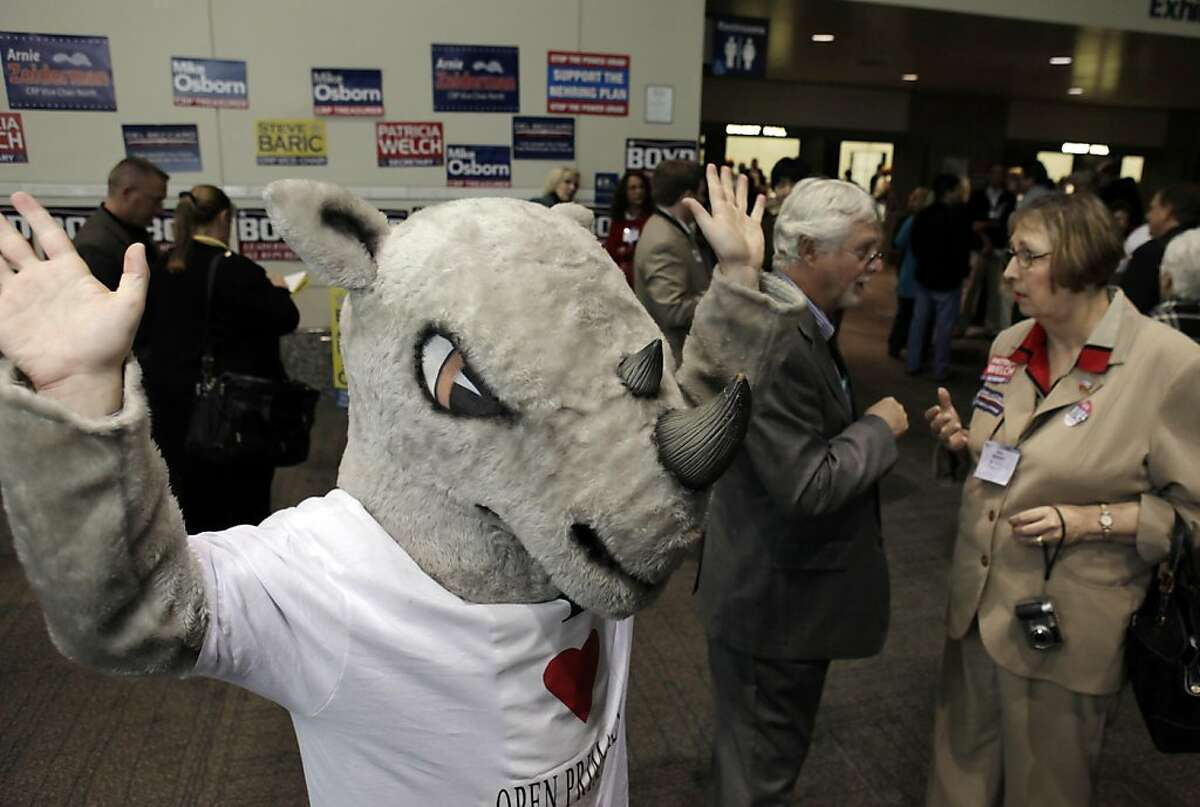 Scott Carpenter of Orange County, dressed as a RINO Rhino (Republican In Name Only) protests new primary system based on Prop. 14. A thousand delegates and republicans from around the state gathered at the Sacramento Convention Center for the California Republican Party Convention in Sacramento, Calif., on Saturday, March 19, 2011.