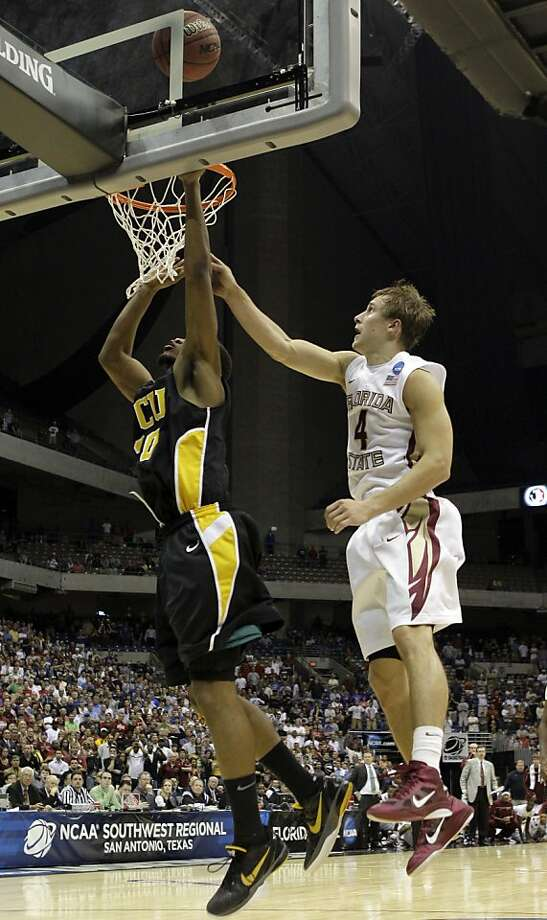Virginia Commonwealth's Bradford Burgess makes the winning shot as Florida State's Deividas Dulkys defends during the overtime at a Southwest regional semifinal game in the NCAA college basketball tournament Friday, March 25, 2011, in San Antonio. VCU won72-71. Photo: Tony Gutierrez, AP