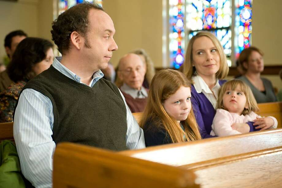 "In this film publicity image released by Fox Searchlight Films, Paul Giamatti, left, Clare Foley II, and Amy Ryan, right, are shown in a scene from, ""Win Win."" Photo: Kimberly Wright, AP"