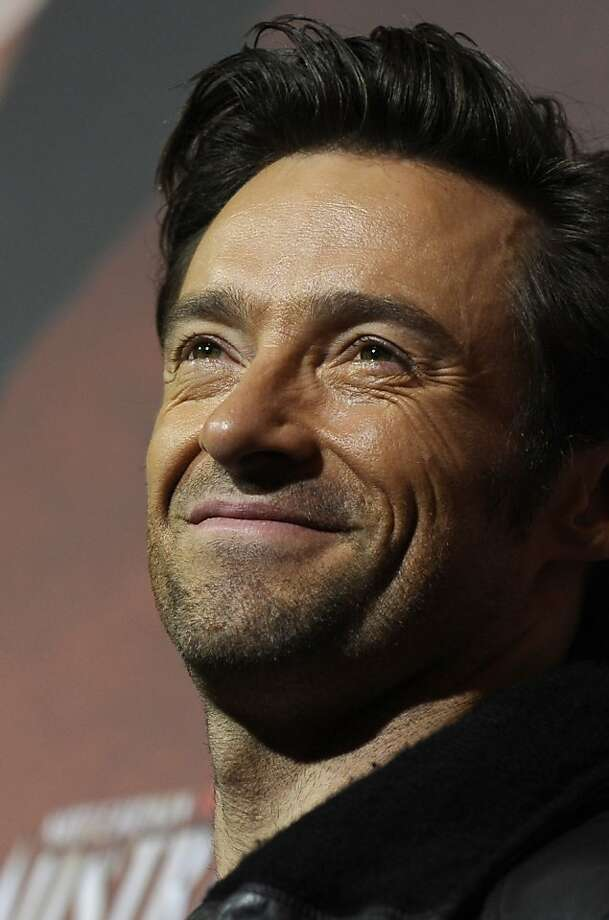 "Australian actor Hugh Jackman poses for photographers during the photocall for the film ""Australia"" on December 12, 2008 in Berlin. The film, directed by Australian director Buz Luhrmann and also starring Australian actress Nicole Kidman, is set to open on December 25, 2008 in the German cinemas. Photo: Michael Kappeler, AFP/Getty Images"