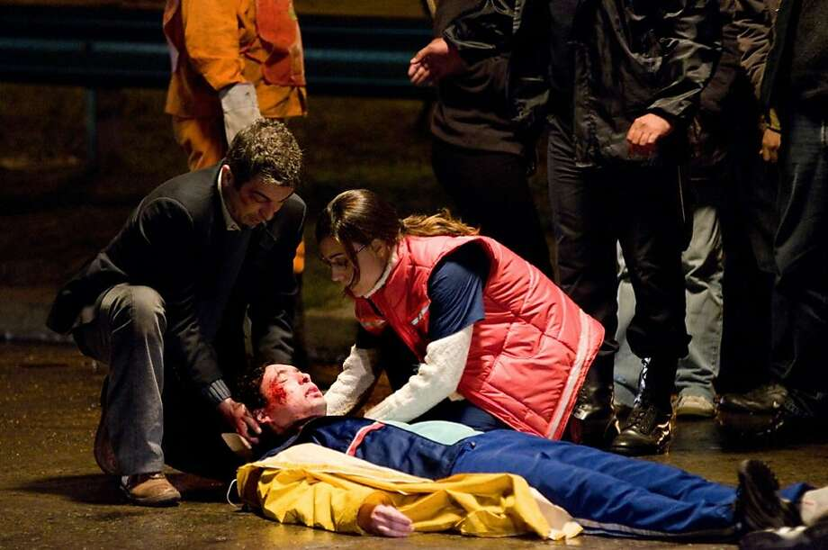 "Ricardo Darin (left) and Martina Gusman tend to a patient in Pablo Trapero's ""Carancho,"" a 2010 film from Argentina. Photo: Strand Releasing"