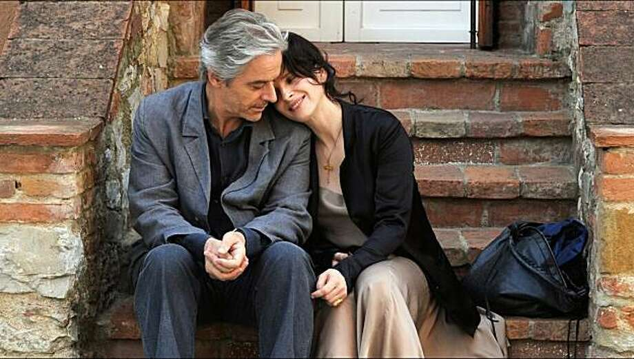 "William Shimell and Juliette Binoche star in ""Certified Copy,"" about a British author promoting his book in Italy, who meets a Frenchwoman who takes him to the village of Lucignano. Photo: IFC Films"