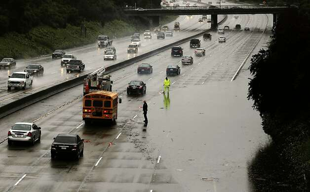 Rain flooded the west bound lanes of the I-580 freeway at the 38th Ave. over crossing, on Thursday Mar. 24, 2011, in Oakland, Ca., as heavy rainstorms rolled through Northern California. Photo: Michael Macor, The Chronicle