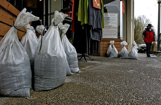 Sandbags at the ready, but were not needed, in front of Hilda's Coffee Shop in downtown, San Anselmo, on Thursday Mar. 24, 2011, as heavy rainstorms rolled through Northern California. Photo: Michael Macor, The Chronicle